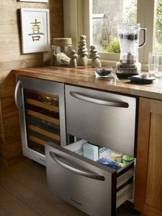 Pull out mini refrigerator next to the wine cooler #Kitchen Appliance Gallery at JM Kitchen Denver Castle Rock Colorado