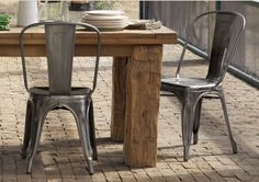 Metal chairs and reclaimed wood farmhouse table