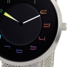 Chroma Watch: a 38mm diameter (1.50 inch) unisex watch utilizing Swiss parts. While Chromas numerals change color every second, the hour hand colors merge from one color palette to another more gradually creating beautiful hues of the color spectrum. See how this watch displays time: