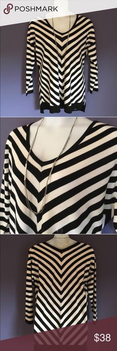 "🆕 Lane Bryant Striped Sweater Wow!  You will make a statement in this sweater!  The stripes are so classy.  The back of the sweater is a little longer than the front. Pair with black pants/leggings and boots.  Size:  18/20. Material:  70% Rayon/30% Nylon.  Measurements:  Length - 29.5"" to 31""/Bust - 26""/Waist - 24"" Lane Bryant Sweaters V-Necks"
