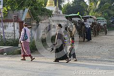 Horse cabs and people on the street in Nyaungshwe village, Myanmar (Burma)