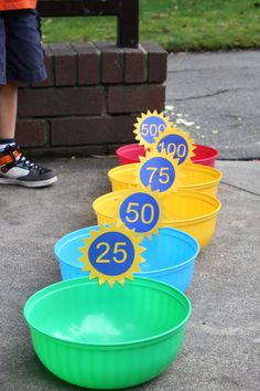 DIY Bean Bag Toss Party Game For Kids...sew up a few bean bags, buy plastic containers from the dollar bin & make up the points labels!  So cute!