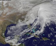 his visible image of the winter storm over the U.S. south and East Coast was taken by NOAA's GOES-13 satellite on Feb. 13 at 1455 UTC/9:45 a.m. EST. Snow covered ground can be seen over the Great Lakes region and Ohio Valley. Image Credit:  NASA/NOAA GOES Project