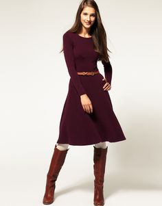 This also comes in navy, which I prefer, but the purple shows the stitch detailing much better.  Love it with the boots!