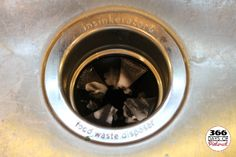 Cleaning the Garbage Disposal with Vinegar and Baking Soda