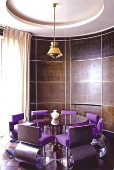 Magnificent black walnut modern contemporary curved paneled walls purple velvet chairs   Pierre Yovanovitcha former couture designer for Pierre Cardin, is now designing interiors. Yovanovitch's own apartment in Paris.