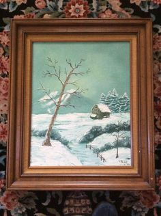 "The painting was done in shades of white and teal green; there is some brown in the cabin, fence and leafless trees in the foreground. The painting is signed by the artist, E. Reich, in the lower right corner; the date is also indicated (""2-82""). 