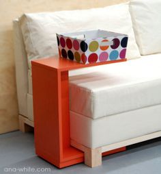 "Make your own ""C"" table. Perfect for storing laptops off the bed."