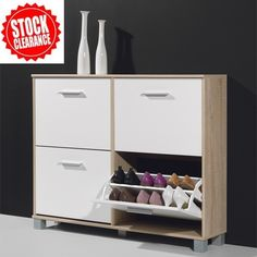 Modern Shoe Storage Cabinet In Canadian Oak And White.£99.95   #furnitureinfashionshoecabinet shoe storage cabinet oak Features:   • A modern shoe cabinet in Canadian Oak & White  • Four pull-down doors with silver finish handles  • Doors are finished in White & Canadian Oak carcass • Quality german furniture constructed with german methods • Can hold approx 24 pairs • At an affordable price   Finish: Canadian #Oak and White  Dimensions:  W115cm x H90cm X D26cm