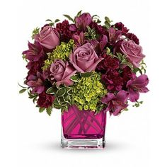 Lovely at first sight. Green miniature hydrangea and lavender #roses are a lovely #combination! This extra-sweet bouquet comes in our fuchsia glass cube. Green miniature hydrangea, lavender roses, purple alstroemeria and maroon miniature #carnations accented with greens.