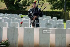 French Piper Claude Lothe plays at the Canadian War Cemetery near Dieppe, France, 18 August 2013, on the eve of the 71st anniversary of the Dieppe raid. More than 6000 allied troops, mostly Canadians, landed on 19 August 1942. At the end of the day, after a fierce battle, the Allies had 1550 dead and some 2400 prisoners. Dieppe's citizens and guests read the names of the 948 Commonwealth servicemen of WWII who are buried or commemorated in this cemetery.