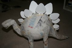 There are lots of ways to make a stegosaurus piñata. If you do an Internet sear… There are lots of ways to make a stegosaurus piñata. If you do an Internet search you'll see many different stegosaurus piñatas. This is how Kerry and I made ours. Paper Mache Pinata, Paper Mache Diy, Dinosaur Projects, Dinosaur Crafts, Dinosaur Birthday Party, Birthday Party Themes, Art For Kids, Crafts For Kids, Baby Party