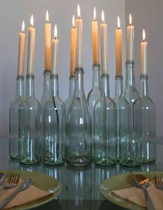 Save a couple of weekends' worth of wine bottles to use as candle holders. | 20 Foolproof Hacks For Throwing The Perfect Dinner Party