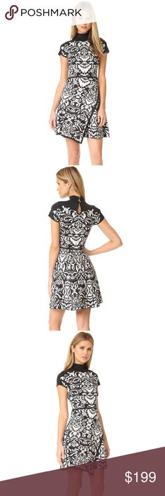 """new/ Parker Stella Grey Ivory Floral Sweater Dress A floral motif lends elaborate detail to this mock-neck Parker fit-and-flare knit dress. Asymmetical faux wrap skirt. Cap sleeves. Button back keyhole. Fitted bodice and defined waist. Unlined.  • size XS • laying flat: 29"""" bust, 28"""" waist, 35"""" length from shoulder, 5.5"""" sleeves • style: stella • Fabric: Intarsia knit • 75% rayon/15% polyester/10% nylon • new and never worn Parker Dresses Mini"""