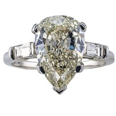 3.27 Carats Pear Shaped Diamond Solitaire Ring | From a unique collection of vintage engagement rings at https://www.1stdibs.com/jewelry/rings/engagement-rings/