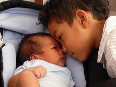 blasian siblings such an adorable photo, love the little boy's curly faux hawk :-)