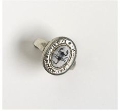 An ancient Roman ribbon-onyx intaglio set in a fifteenth-century silver ring; the intaglio is engraved with a scorpion, symbol of the zodiacal sign of Scorpio and believed to cool fever and heal from poisoning. (Victoria & Albert Museum)