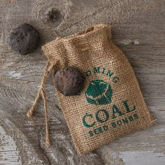 """Blooming Coal Seed Bombs-- Soil enriching clay, non-toxic dye, worm castings, seeds, burlap bag - Seeds: annual gaillardia, baby blue eyes, black eyed susan, calendula, dwarf cosmos, French marigold, lance-leaved coreopsis, plains coreopsis, perennial gaillardia, perennial lupine, purple coneflower, red poppy, sweet alyssum - Instructions and plant list included - Handmade in the USA  4""""W, 6""""L"""