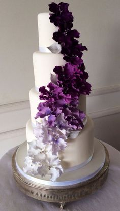 Stunning! ~Purple reign 4 tier wedding cake with purple ombré fantasy flowers cascading down the front.~ entirely edible