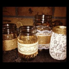 Country/Rustic wedding centerpieces. Burlap, lace & mason jars.