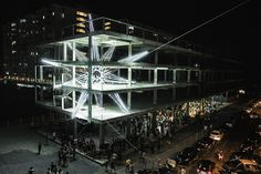 Malaysian artist Jun Hao Ong constructed this bright LED star that appears to shoot through the floors and ceilings of a 4-story concrete building as part of the 2015 Urban Xchange public art festival. The piece is comprised of steel cables that help suspend a network of over 500 feet of LED light