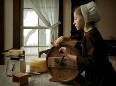 Amish Girl Churning Butter