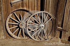 Two old wooden cart wheels