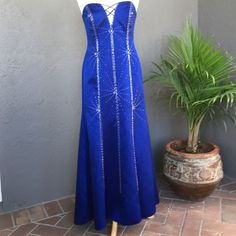 Blue beaded Prom Dress gown size tag 10 - fits 6-8 Exquisitely beaded prom gown made of silky satin-like, 100% polyester with 100% polyester lining in beautiful midnight blue. The dress has full fitted bodice bra type inner enclosure and blind zipper back. Size on tag is 10 but fits better as a 6-8. Laying flat it is 16 inches wide directly under the bust. Waist is 15 inches wide. Hips are 20 inches wide. 48 inches from strapless top to hem bottom. 23 inch slit over left front leg. It is…