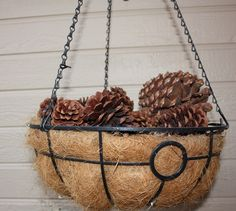 Cinnamon scented pine cones in hanging baskets for fall/winter