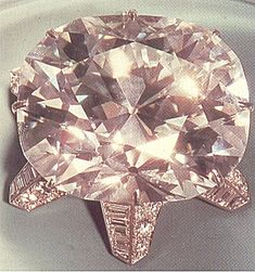 The Jubilee diamond weighs 245.35 carats and is the 6th largest cut diamond in the world.  Found in the Jagersfontein Mine in Africa in 1895 and currently owned by Robert Mouawad, the stone was cut from the original rough of 650 carats in Amsterdam by M B Barends. The cut is a combination of characteristics of both rose, cushion and brilliant cuts with a table replaced by 8 facets meeting in the center and a total of 88 facets.