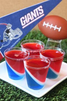 New York Giants Jell-O Shots (3 oz. box berry blue Jell-O 3 envelopes Knox plain gelatin 2 1/2 cup vodka Blue food coloring 1/2 cup milk 1/8 cup granulated sugar 3 oz. box cherry Jell-O)