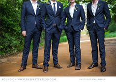 Groom and groomsmen in classic navy suits.