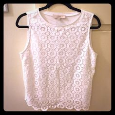 Sleeveless top Beautiful sleeveles top with a flower embroidered knit over white 100% cotton. Goes amazing with skinny jeans or a cute skirt. Looks yellowish in second pics because of my crappy lighting but its a true white color. Any questions message me! LOFT Tops Tank Tops