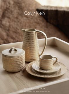 The Gold Fleck dinnerware collection from Calvin Klein Home is highlighted by dabs of gold, versatile enough for both casual and formal entertaining.
