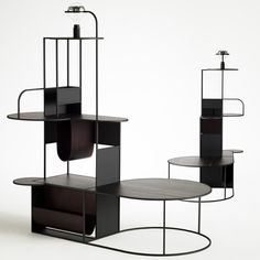 Dutch designer Roderick Vos has designed an Art Deco shelving unit inspired by Manhattan skyscrapers. The unit, called 'Downtown', consists of matt black vertical planes, wooden platforms and square metal tubes. The design was created for the Dutch brand Linteloo