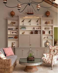 This Entertainment Center can be very functional as well as hidden for more formal gatherings. It also would work in a naturalistic/nautical theme.