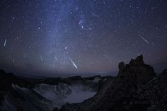 Known in the north as a winter meteor shower, the 2014 Geminids rain down on this rugged, frozen landscape. The scene was recorded from the summit of Mt. Changbai along China's northeastern border with North Korea as a composite of digital frames capturing bright meteors near the shower's peak. Orion is near picture center above the volcanic cater lake. The shower's radiant in the constellation Gemini is to the upper left, at the apparent origin of all the meteor...