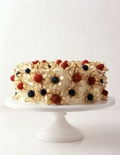 Cute! Raspberries and blueberries turned into flowers with almond slivers. by milagros. Ellis birthday cake?