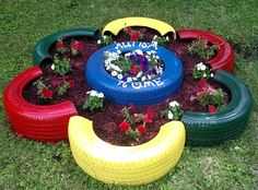 Autism themed tire flower creation I made.