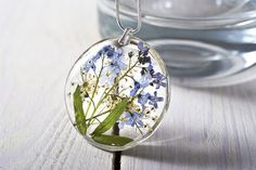 Delicate resin pendant with forget me not pressed flowers:  - handmade from clear resin - very light and comfortable - entirely handmade by us  - hand pressed forget me not flowers -...