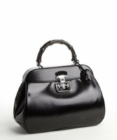 Gucci: black leather 'Lady Lock' top handle bag