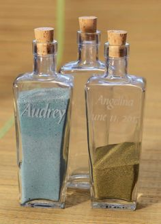 Personalized Unity Sand Ceremony Vases.   Sapphire sand for Michael, Emerald sand for Mike & Ruby sand for me. Plus I can etch the bottles myself using my Cricket
