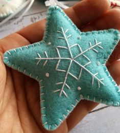 Wool Felt Christmas star ornaments red, blue and grey Snowflake Star Pattern Felt Christmas Decorations, Christmas Ornaments To Make, Christmas Sewing, Christmas Projects, Handmade Christmas, Holiday Crafts, Christmas Crafts, Embroidered Christmas Ornaments, Felt Christmas Trees