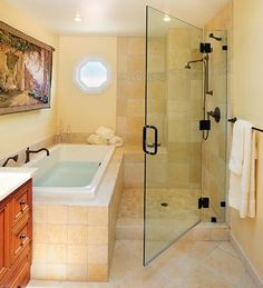 This could work with shower in current location and tub pushed back farther to make room for toilet.  Looks like there is a nice ledge/seat at far end of shower