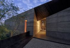 This desert home was constructed from excavated soil and cement, one of the oldest methods of construction called rammed earth.