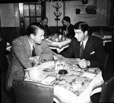 "Yankee players, ""Lefty"" Gomez (left) and Joe DiMaggio, enjoy breakfast at the Gunter Hotel. Circa 1940."