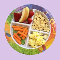 Scrambled eggs, whole grain cereal, apple slices and strawberries, carrots