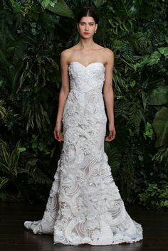 THE SOPHISCATE:  It's all about sleek lines and lots of surface interest. Naeem Khan Bridal Fall 2014 - 2014 Bridal Trends - The recent fashion shows proved that there's a unique look for every type of bride...SEE THEM ALL HERE: http://www.durhamplace.com/2014-bridal-trends/