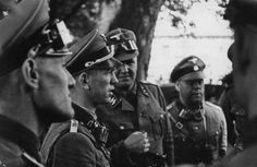 Kurt Meyer(2nd in,facing right),..at a group Officer's meeting in the field,..