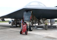 Airmen of 509th Aircraft Maintenance Squadron work on B-2 Spirit bomber during deployment,Andersen AFB,Guam,Aug.22,2014.Bombers & approximately 200 support Airmen,assigned to 509th Bomb Wing at Whiteman Air Force Base,Mo.,deployed to Guam Aug. 6, 2014 to improve combat readiness & ensure regional stability.Bomber deployments help maintain stability in the region while allowing units to become familiar with operating in the theater according to USPACOM.(USAF Senior Airman Cierra Presentado)